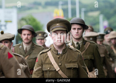 Young men dressed in First World War uniforms in Aberystwyth Wales as part of a UK-wide project to commemorate the - Stock Photo