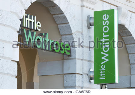 Signs above the Waitrose store front in Poundbury, Dorchester, Dorset, England - Stock Photo