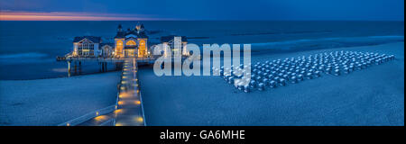 evening photograph of the pier, Sellin, Ruegen Island, Mecklenburg-West Pomerania, Germany - Stock Photo