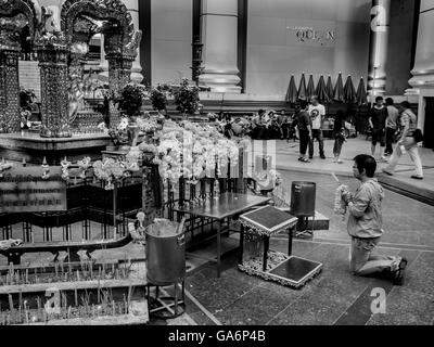 Worshiper at the Erawan Shrine Bangkok Thailand - Stock Photo