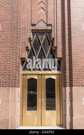 Close up of gold door on the landmarked art deco Western Union Building (60 Hudson Street) in Tribeca, New York. - Stock Photo