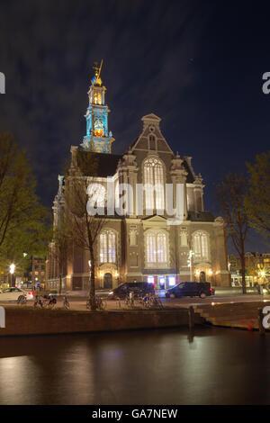 Night shot of the Westerkerk or Western Church in Amsterdam, Netherlands in spring. - Stock Photo