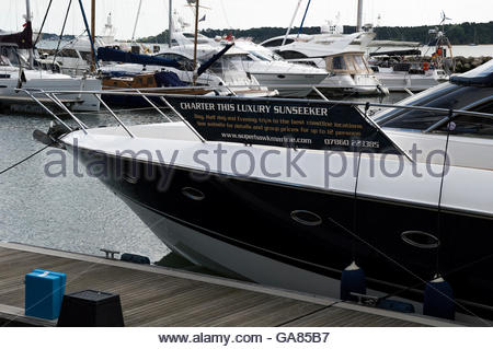 'Charter This Luxury Sunseeker' sign attached to a yacht moored in Poole Harbour, Dorset - Stock Photo