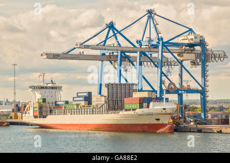 Container Ship Being Unloaded In The Harbour Copenhagen Denmark - Stock Photo