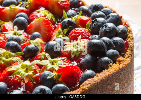 cheese cake with strawberries and blueberries - Stock Photo