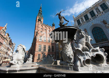 The world famous iconic staue of Neptune on the fountain next to the town hall by the greek gate in old town Gdansk, - Stock Photo