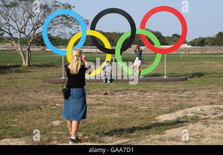 People take pictures of the Olympic rings in the Olympic Equestrian Centre in Deodoro, Rio de Janeiro, Brazil, 04 - Stock Photo