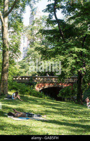 Park Goers Enjoying the Area near Driprock Arch in Central park, NYC, USA - Stock Photo