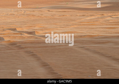 Shifting desert sands creating natural patterns in the desert - Wahiba Sands Oman - Stock Photo