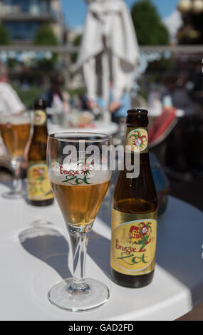 A cold glass of Zot beer at a restaurant in town, De Panne, Belgium. - Stock Photo