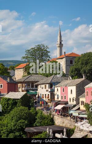 Mostar, Herzegovina-Neretva, Bosnia and Herzegovina.  Old town seen from the Stari Most, or Old Bridge. - Stock Photo