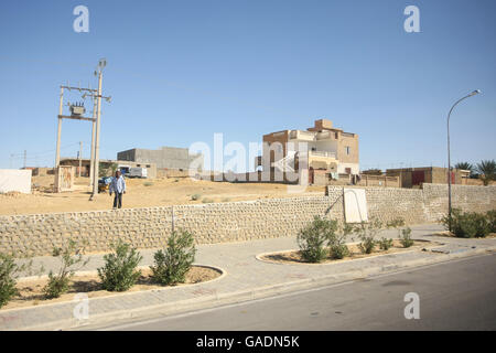 TOZEUR,  TUNISIA - SEPTEMBER 16, 2012 : Tunisian architecture next to the road in Tozeur, Tunisia. - Stock Photo