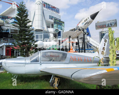 A group of airplanes displayed in front of the Hawaii Shopping Center in Port El Kantaoui tourist complex in Tunisia. - Stock Photo