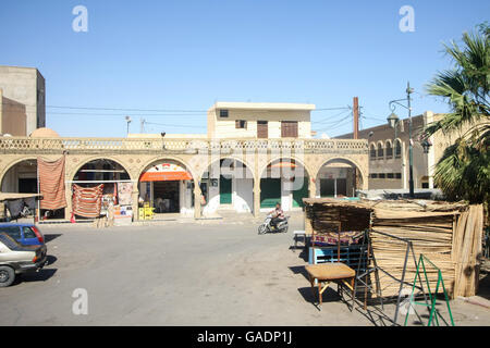 TOZEUR,  TUNISIA - SEPTEMBER 16, 2012 : A town square with shops and food stands in Tozeur, Tunisia. - Stock Photo