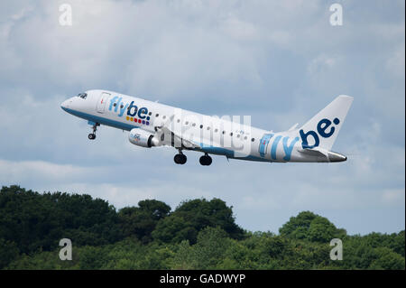 A Flybe Embraer 175 takes off from Manchester International Airport (Editorial use only) - Stock Photo