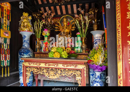Buddhist shrine to bodhisattva Avalokiteshvara in the One Pillar Pagoda (Chua Mot Cot), Ba Dinh, Hanoi, Vietnam - Stock Photo