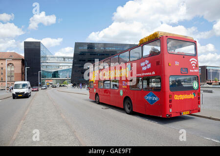 Sightseeing tour bus at the waterfront at the Royal Library, the Black Diamond, Den Sorte Diamant, at Søren Kirkegaards - Stock Photo