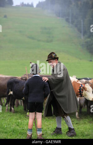 Boy and man wearing traditional costume during Viehscheid, Thalkirchdorf, Oberstaufen, Bavaria - Stock Photo