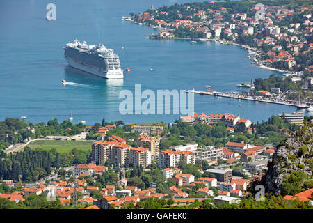 View from above looking down on town & Bay of Kotor Montenegro cruise ship liner Regal Princess using tenders to - Stock Photo