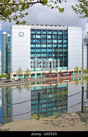 Global Switch data centre provider premises in East India Docks East London England UK with reflections in landscaped - Stock Photo