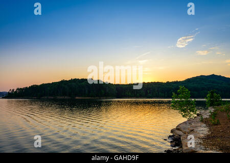 An amazingly colorful sunset over Cave Run Lake in the Daniel Boone National Forest. Captured at Windy Bay Fishing - Stock Photo