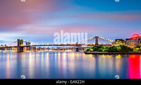 Illuminated Brooklyn Bridge at dusk viewed from Pier2 park in New Yok City Stock Photo