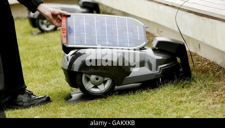 Zero emission solar powered lawn mower launch - Stock Photo