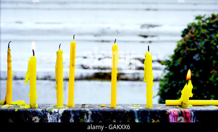 Candle light in the temple daytime, Thailand - Stock Photo