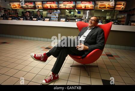Designer to the stars unveils fast-food uniform - Stock Photo