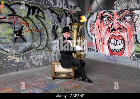 busker musician playing tuba at borough market, london, england - Stock Photo