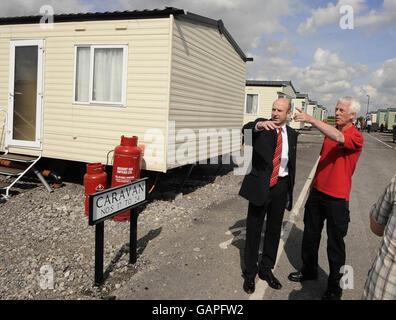 1,400 flood families 'Still living in caravans' - Stock Photo