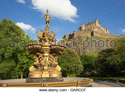 Evening sunshine on the Ross Fountain in Princes Street Gardens with the castle visible behind, in the city centre - Stock Photo