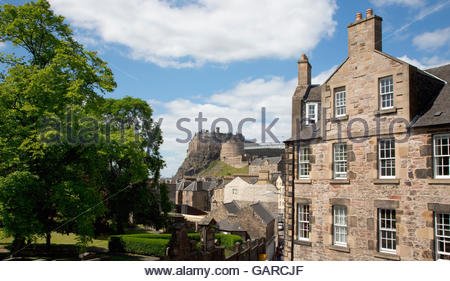 Looking down Candlemaker Row with Edinburgh Castle visible beyond, in the city centre of Edinburgh, Scotland. - Stock Photo