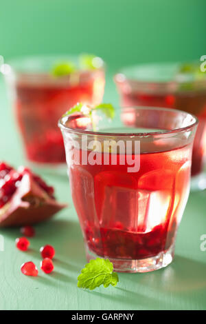 summer pomegranate drink with melissa - Stock Photo