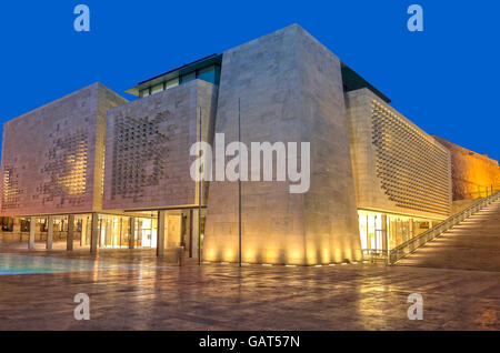 Malta, Valletta: Night view of the new modern building of the Maltese Parliament. - Stock Photo