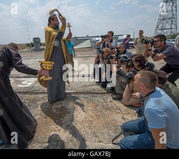 A Russian Orthodox priest blesses members of the media after the traditional blessing of the Soyuz rocket on the - Stock Photo