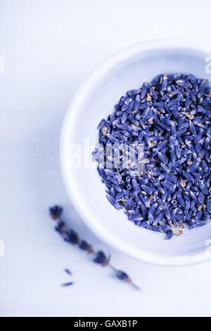 Purple lavender in a small white bowl - Stock Photo