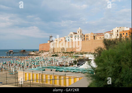 beach below the fortified old town of Termoli,  region of Molise, Italy - Stock Photo