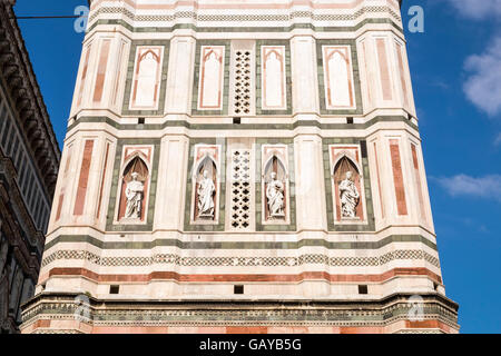 Detail of the facade of the bell tower with statues, cathedral of Santa Maria del Fiore, Florence, Tuscany, Italy - Stock Photo