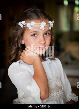 Beautiful little girl on the head wreath of small flowers - Stock Photo
