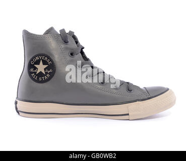 Side view of a Converse Chuck Taylor All Star rubber sneaker isolated on white background - Stock Photo