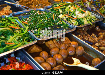 Street Food Stall serving Chinese Delicacies such as ...