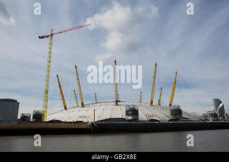 The O2 at Greenwich in London, England. The events venue, formerly known as the Millennium Dome, stands by the banks - Stock Photo