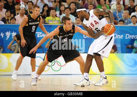 USA's Lebron James (right) and in action against Germany's Konrad Christoph Wysocki, during the Men's Preliminary Round Group B match at the Olympic Basketball Arena, at the 2008 Olympic Games in Beijing, China.