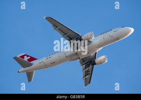 AMSTERDAM, THE NETHERLANDS - FEBRUARY 18, 2015 Bottom of an airbus A320 of airline Swiss International Airlines - Stock Photo