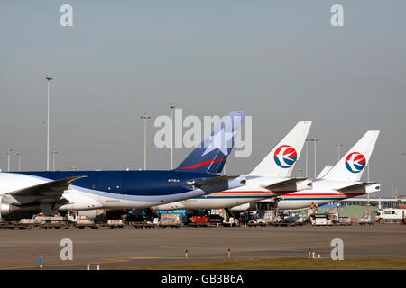 AMSTERDAM, THE NETHERLANDS - FEBRUARY 18, 2015 Three parked cargo planes at Schiphol Airport links the control tower - Stock Photo