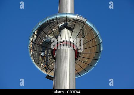 Looking up at Brighton's new i360 moving observation tower, showing the underneath reflecting the Brighton seafront. - Stock Photo