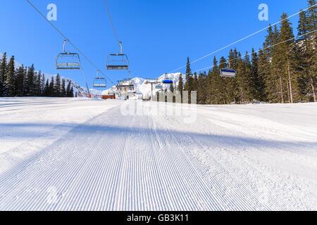 Freshly groomed ski slope in Rohace winter resort, Tatra Mountains, Slovakia - Stock Photo