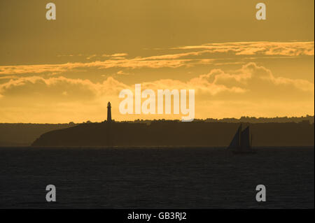The sun casts a golden glow as it sets over Flatholme lighthouse situated in the Bristol Channel between Weston-super-Mare and Cardiff bringing some welcomed relief after the recent poor weather that has covered much of the UK.