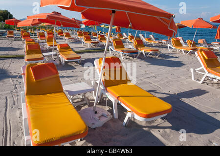 Empty sunbeds on Lambie Beach, Lambi, Kos (Cos), The Dodecanese, South Aegean Region, Greece - Stock Photo